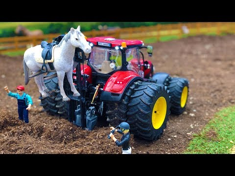 BRUDER tractor saves HORSE stuck in the MUD! Action video for kids | Farming toys